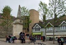 Photo of Bonn Square in Oxford with people sitting on the Tirah monument