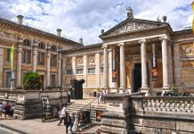 View of entrance of Ashmolean Museum on sunny day with a few clouds.