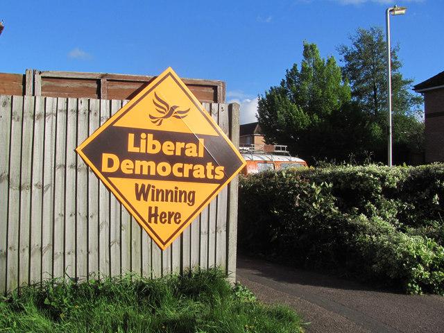 A diamond-shaped yellow sign saying